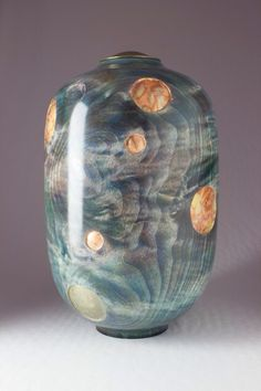 Bubbles In The Stream. Coloured & Carved Figured Sycamore lidded vessel or cremation urn. The bubbles have been carved and gilded with various colours of metal leaf. Wood Turning Projects, Cremation Urns, Sculpture, Wooden Bowls, Surface Design, Wood Art, Vases, Embellishments, Cool Designs