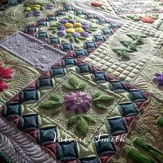 I absolutely loved quilting this one! It was so much fun thinking up different backgrounds for each of the appliqués.      The pattern is c...