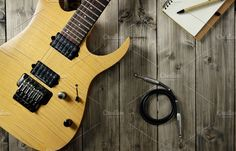 Guitar on Wood Top, Notepad & Cable by NikoKolev on @creativemarket