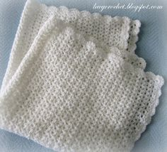 V-Stitch Baby Afghan with Scalloped Trim, free pattern from Lacy Crochet.  Super-easy  should work up fast.  #blanket #throw