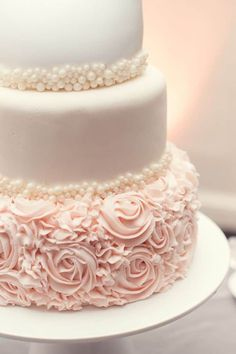 Beautiful blush wedding cake! You could choose all ivory instead of blush and maybe smooth buttercream instead of fondant!  Image source