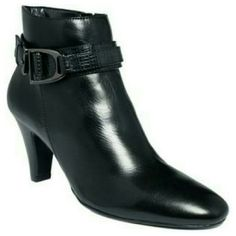 Black Bandolino boot's Sofisticated boot's by Bandolino, .Very pretty good condition .with the size of 8' .this beautiful piece that u will love has 3 'inches heel's .. Note a little spot to the front see pic # 2 its noteceable  I just want to be specific .. Bandolino Shoes Heeled Boots