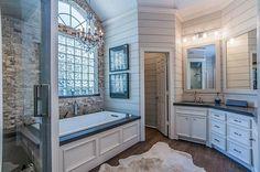 Rustic Farmhouse bathroom with shiplap walls and stonework.
