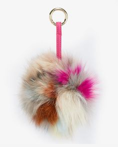 Jocelyn Super Swirl Pom Bag Keychain: The Fox fur pom pom is a chic charming addition; features a ring and leather strap—simply attach it to your bag. Please note colors may vary ...