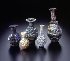 An Assemblage of Roman Mold-Blown Glass Head Flasks 3rd cent.AC, held scented oils