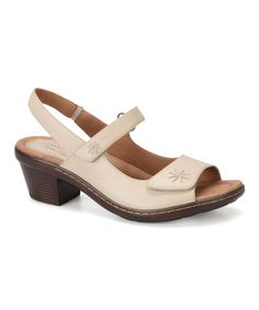 Beige Christel Leather Sandal -  Full-grain leather shapes these earthy-meets-urban sandals styled with two adjustable hook and loop straps and elastic goring at the back. A padded leather footbed lends lasting comfort.      2.25'' heel     Hook and loop closure     Leather upper     Padded leather footbed     Leather lining     Rubber sole     Imported