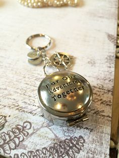 love this gold compass for the adventure together
