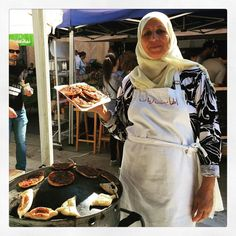 The very lovely Samira Ismael showing me her muhammara or محمرة pizzas. Delicious. Both her pepper paste and Makdouss مكدوس totally yummy at @soukeltayeb #Beirut #Lebanon by anissahelou