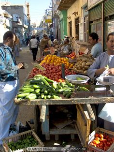 Market scene with local Nubians selling and buying vegetables, Aswan, Egypt | Alfred Molon