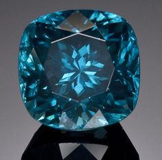 Blue Zircon  Cambodia  A fine cushion-cut, deep electric blue zircon with excellent luster and clarity.   Weighing approximately 9.1 carats and measuring 9.9 x 9.85 x 9.85mm.