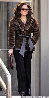 love the glasses,dolman-sleeve mink jacket, and necklace.