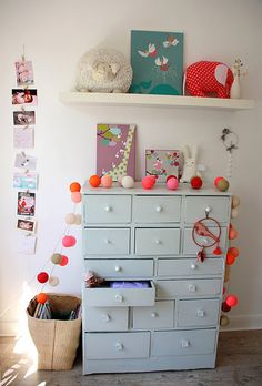 This is the coolest dresser! So many drawers! It would be perfect for a kid's or baby's room.