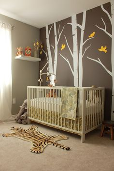Gray and yellow nursery with birch tree decals