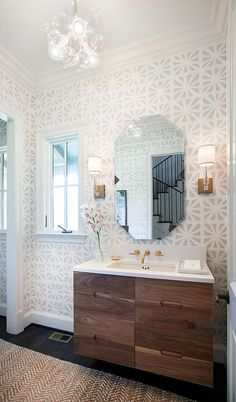 Powder Room Ideas. Transitional powder room with geometric wallpaper and Glass Bubble Chandelier. #PowderRoom -- love the vanity