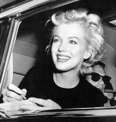 Marilyn Monroe singing an autograph on her birthday 1956