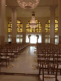 Soft glow, romantic lighting for a wedding in Whitehall with historic chandeliers and stained glass windows at Southern Exchange at 200 Peachtree - historic downtown Atlanta wedding and event venue
