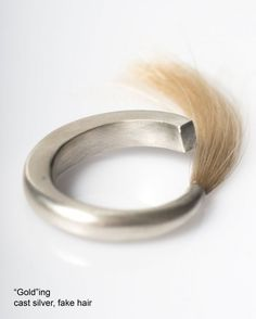 I would absolutely wear this and have both my children's hair blended into the ring.