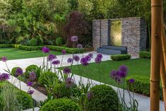 A garden for outside use all year with an exterior gas fireplace all weather (artificial) turf and a quartzite and mirror polished steel water featur Terrace Garden, Garden Spaces, Landscape Plans, Landscape Design, Landscape Architecture, Architecture Design, Back Gardens, Outdoor Gardens, Back Garden Design