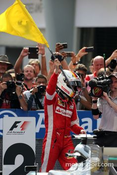 Sebastian Vettel in a Scuderia Ferrari won the Malaysia GP, Mar. 29, 2015.