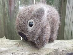 Wombat plush is soft and squeezable, and loves snuggles! Hand knit from my own original pattern with all natural fibers, then felted for cuddliness and durability. Safety eyes are securely felted in place, but Wombat is not for anyone young enough to still be chewing their toys as small pieces could possibly pose a choking hazard. Wombat is approximately 6 1/2 long and stands approx. 5 high. Wombat is part of a large brood and you may not receive the Wombat pictured, but yours will be ha...