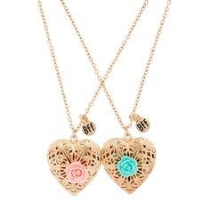 "<P>Show off friendship and style. These ornate gold heart lockets both adorned with a pastel rose are a great way to match your BFF. Includes 1 green and 1 pink.</P><UL><LI>Chain: 19 1/2""L<LI>Pendant: 1""L x 1""H<LI>Lobster clasp closure<LI>Materials: Metal</LI></UL>"