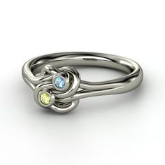 Sterling Silver knot ring with both his and hers birthstones.  I would have my sons' birthstones.