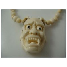 A genuine vintage elephant ivory carved Japanese devil mask necklace. The function of the mask is to ward off evil spirits, it is signed on the back by the sculptor. This is in fact the only one in our ivory jewelry collection  The necklace has a nice creamy ivory patina.