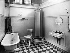 a black and white photograph of a 1930s bathroom