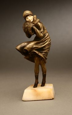 Art Deco patinated and gilt bronze, ivory and onyx figure of a woman, 'The Squall', Demetre H. Chiparus, ca.1925.