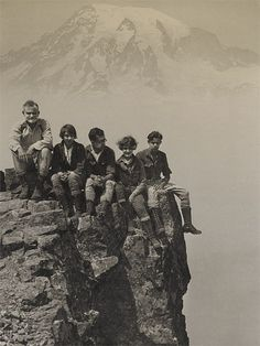 THE MAKING OF MOUNTAINEERS Two women and three men on a mountaineering expedition sit atop Pinnacle Peak at Mount Rainier National Park. The photo, which is part of the Rainier National Park Mountain-Glacier Wonderland Photograph Album, is dated circa 1925.