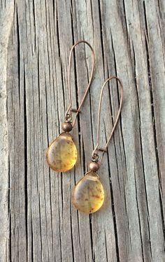 """Long antiqued copper hooks with speckled amber Czech glass teardrops. Approx 2""""…"""