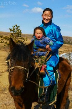 Young Mongolian woman and child