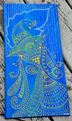 Henna style peacock painting on upcycled wood - the background is peacock blue with slight shades of purple. @Bala Thiagarajan, 2012 (sold)
