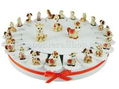 22 Slice favour cake decorated  with cute animal figurines and filled with with a choice of dragees, candy, sugared almonds, sweets. A great fun idea for children. Made in Italy. Italian bomboniere. Cute idea for a baptism, christening, communion #italian #favour #favor #centrepiece #display http://www.bombonierashop.com/en/department/12/Favour-Cakes.html