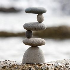 """6 part natural beach pebbles / small river rocks stacked side to side with metal rod supports. Size: Approx. 11""""H Weight: 7-8 lbs."""