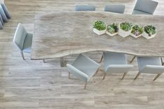 Morgan Harrison Home - Blue upholstered dining chairs surround a gray live edge dining table.