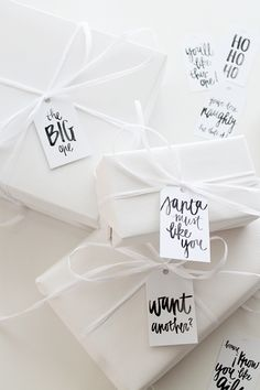White Christmas wrapping with brush lettering.