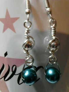 Aqua Pearl accented with silver swirls Earrings