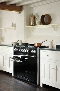 The Mercury 1200 in Liquorice black looks perfect in this rustic themed kitchen, proving that the timeless design of the Mercury range cookers makes them a superb addition for every style of home.