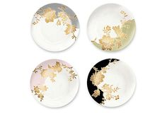 These porcelain plates with a gold floral motif are so beautiful!