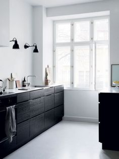 black cabinets and white walls