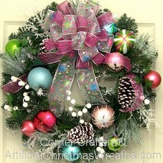 Tis the Season Christmas Wreath - 2013 - 'Tis the Season' for beauty with this lovely wreath adorned with colorful Christmas balls, pine cones, frosted tips, and a lovely pink bow! #ArtificialChristmasWreaths #ChristmasWreaths #Wreaths #PinkWreaths