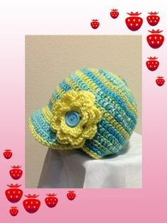 Ultra-soft acrylic newsboy style cap.  Accented with crocheted flower.