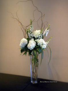 Tall Centerpiece: Hydrangeas, Delphinium, curly willow  grasses...  LOVE THIS!!