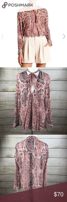 Alice + Olivia Anabel Slim Tie Neck Tunic Blouse In like new condition. Size medium. Alice and Olivia. Red, white and black. Paisley print. Tie neck. Front- 26 inches, back- 28 inches long. Alice & Olivia Tops Blouses
