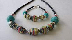 Hey, I found this really awesome Etsy listing at https://www.etsy.com/listing/229671486/paper-bead-necklace-and-bracelet-set