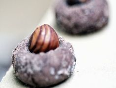"""""""Black souls"""", cacao balls topped with hazelnut. Christmas Sweets, Christmas Cookies, Xmas, Czech Recipes, Cupcake Cakes, Cupcakes, Sweet Recipes, Baking Recipes, Sweet Tooth"""
