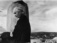 Portrait of Artist Georgia OKeeffe Sitting on the Roof of Her Ghost Ranch Home