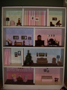 Dollhouse ~ from a repurposed bookcase. I think a repurposed armoire with doors that shut, would be perfect too! {maybe painted pastel colors with an added triangular roof on top} Imagination is running wild with this idea, LOL!