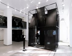 SET architects wraps steel-framed installation with black cloth
